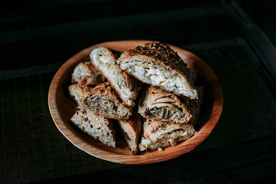 Spicy bread dough corners with cheese and spinach filling