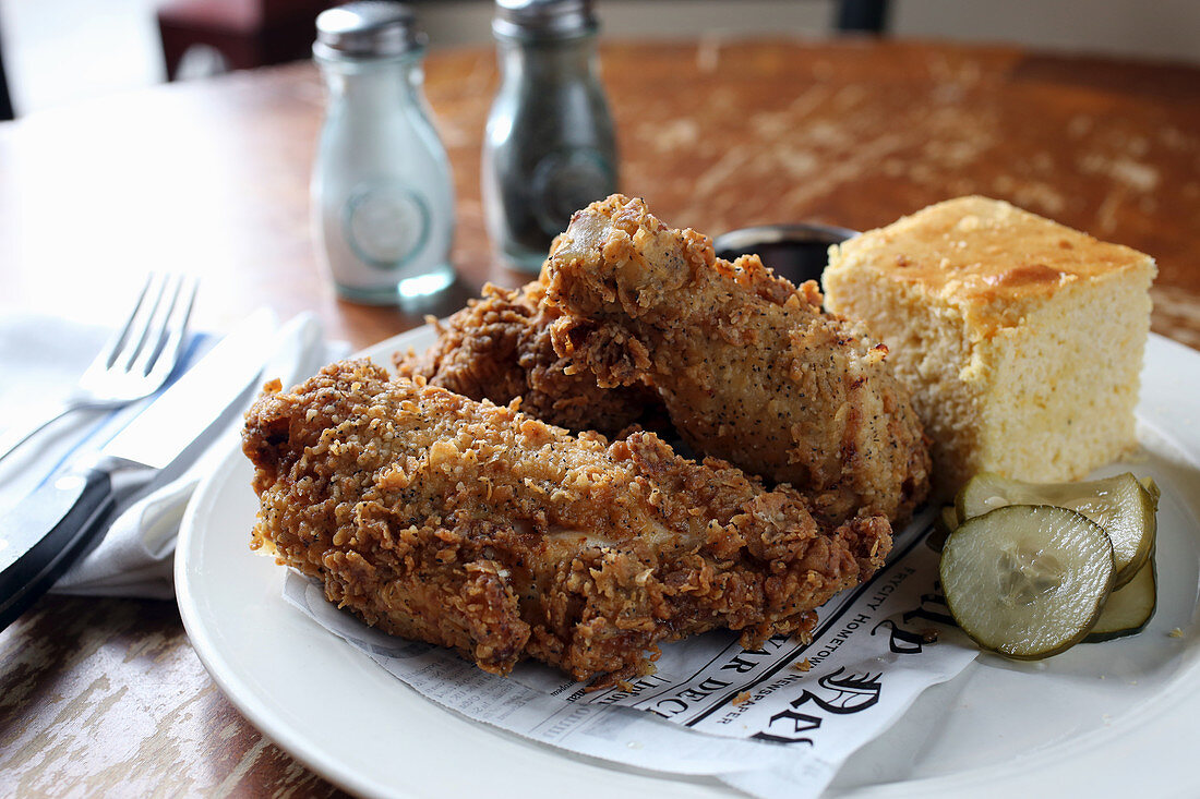 Plate of fried chicken, corn bread and pickles