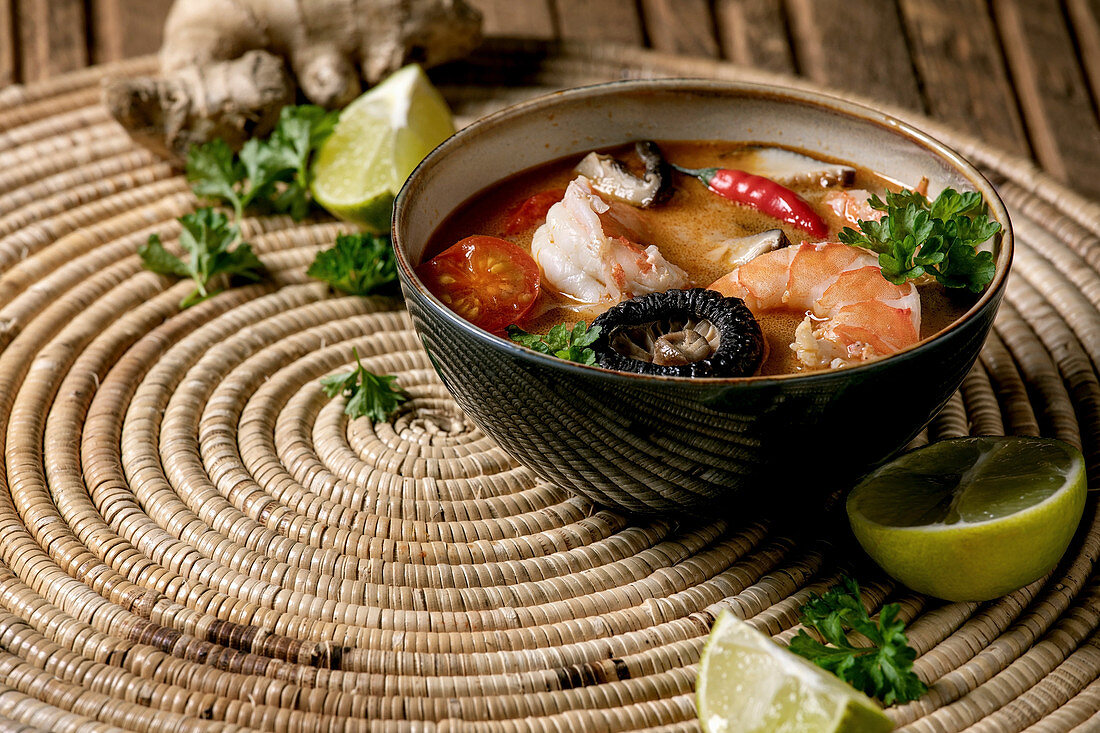 Traditional spicy Thai soup tom yum kung with shiitake mushrooms and prawns