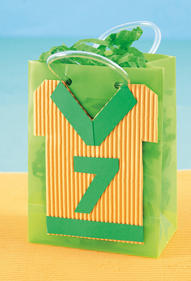 Handmade paper loot bag with jersey motif for rugby-themed party