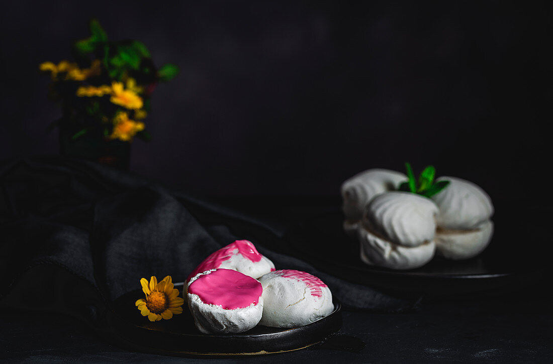 Homemade white Zefir or Zephyr (Russian traditional dessert with mint and strawberry syrup)