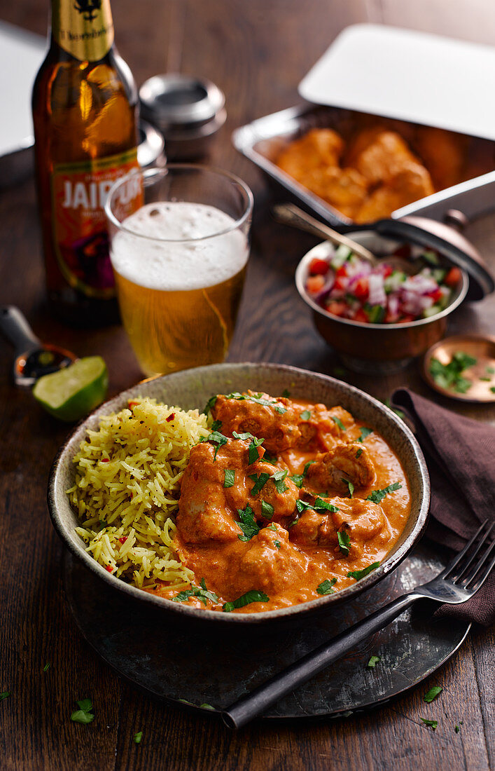 Chicken tikka masala with rice, salad and beer