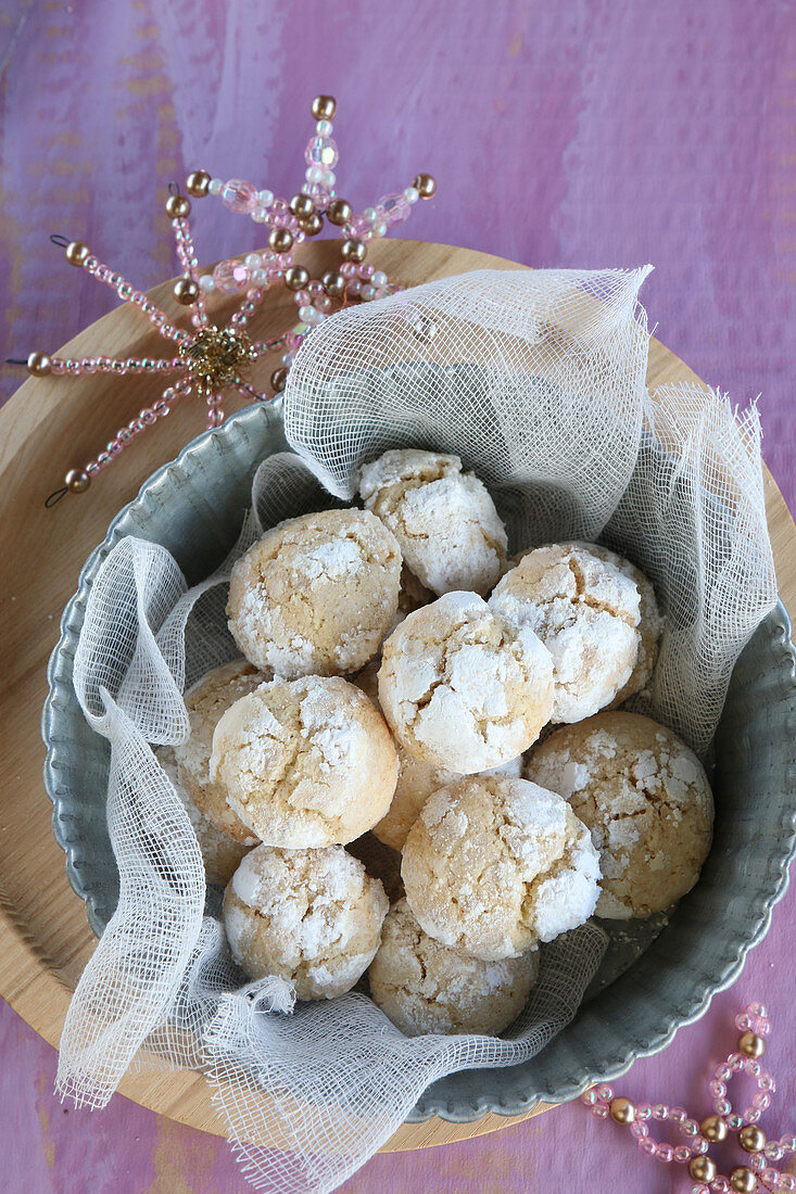 Gluten-free snowball cookies dusted with icing sugar and with beaded stars