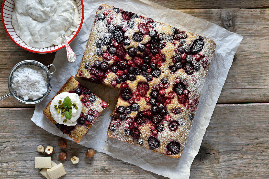 Vegan semolina and hazelnut cake with berries and white chocolate and cream cheese frosting