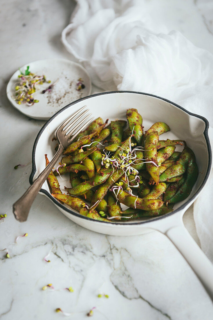 Bowl with edamame dish on table
