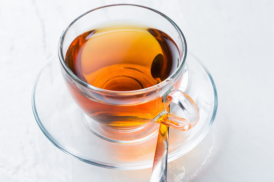 Glass cup of aromatic hot tea