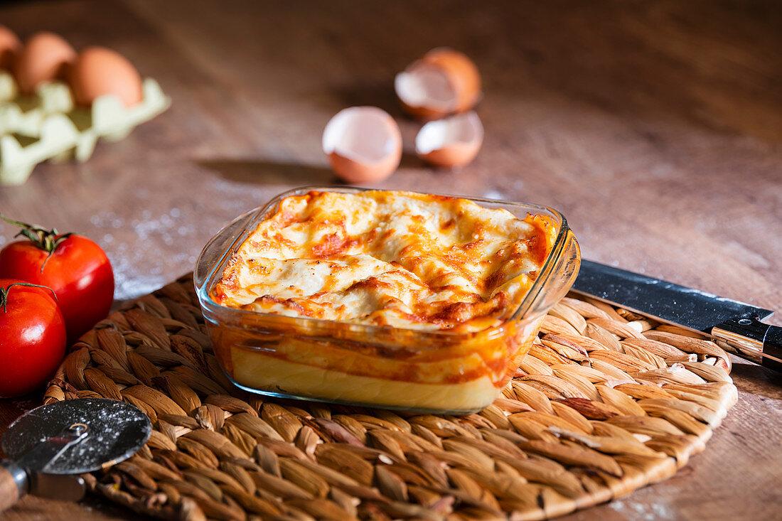 Homemade lasagna in transparent glass bake bowl