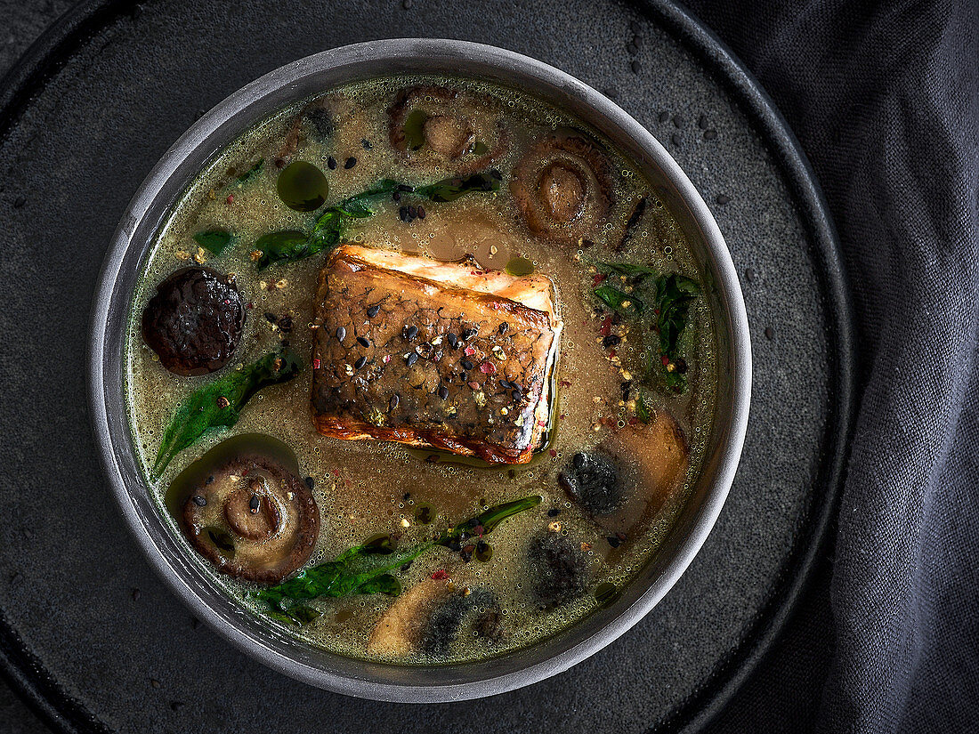 Soya milk soup with grilled salmon, mushrooms and vegetables