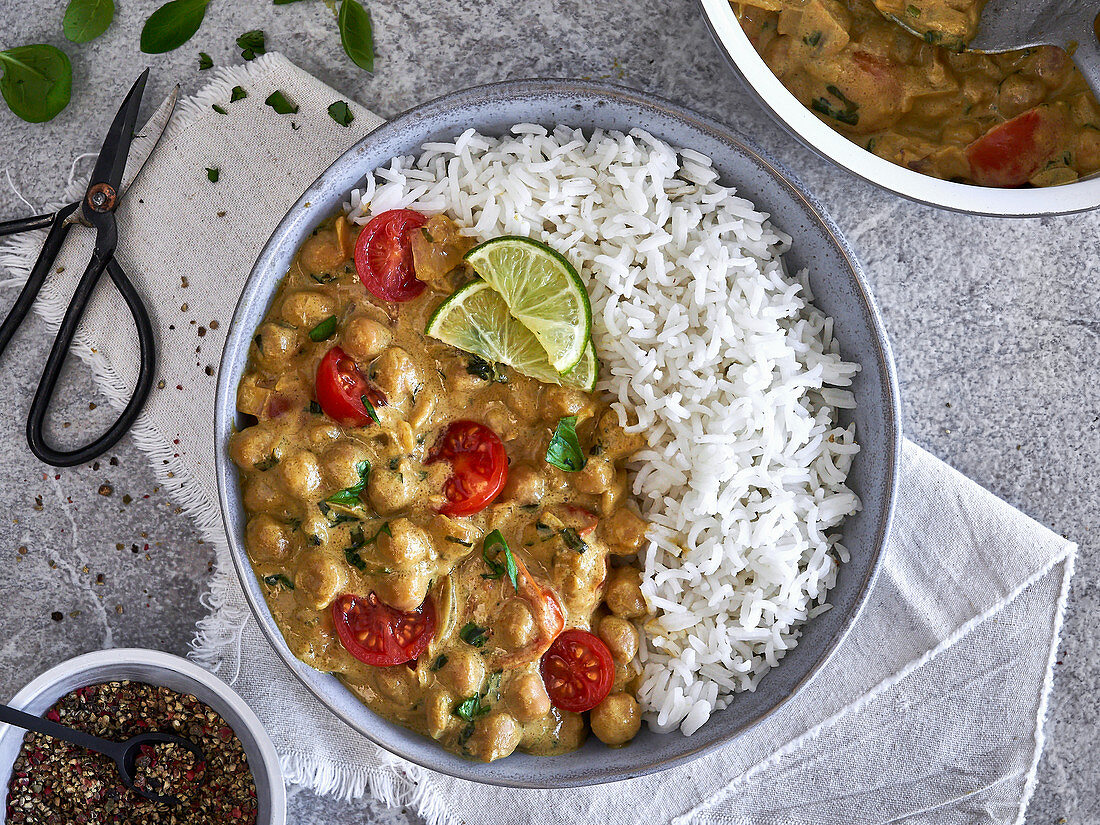 Chickpea curry with cocktail tomatoes served with rice