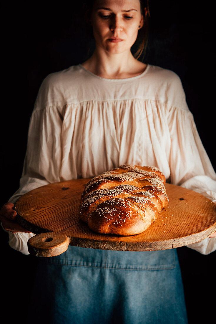 Woman serving Challah bread