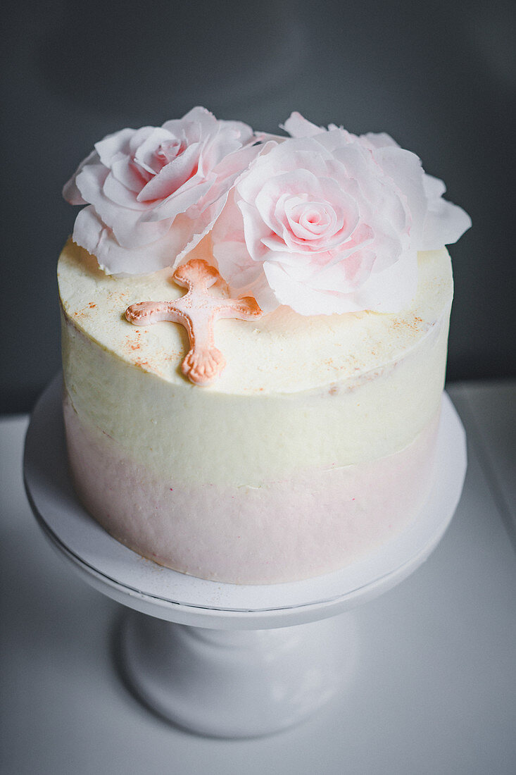 A white chocolate cake with edible paper roses