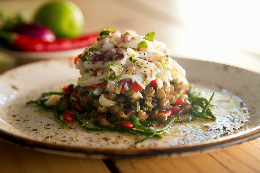 Ceviche with sepia and lentils