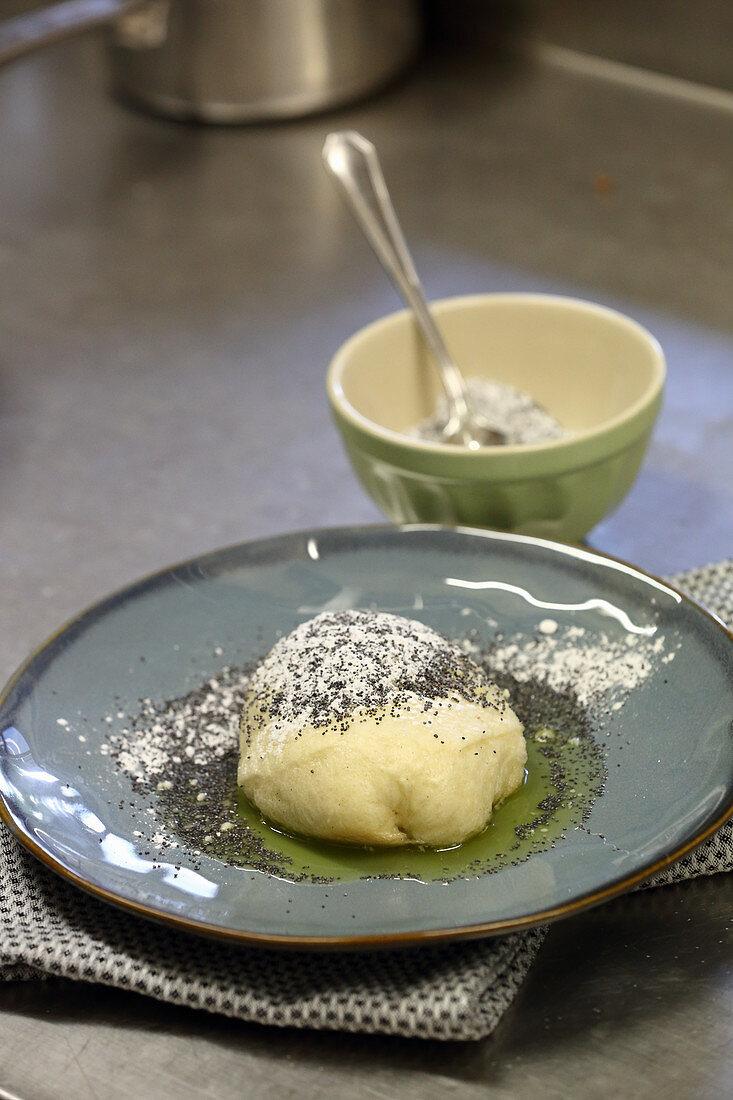 Germknödel (steamed, sweet yeast dumpling) with stewed plums
