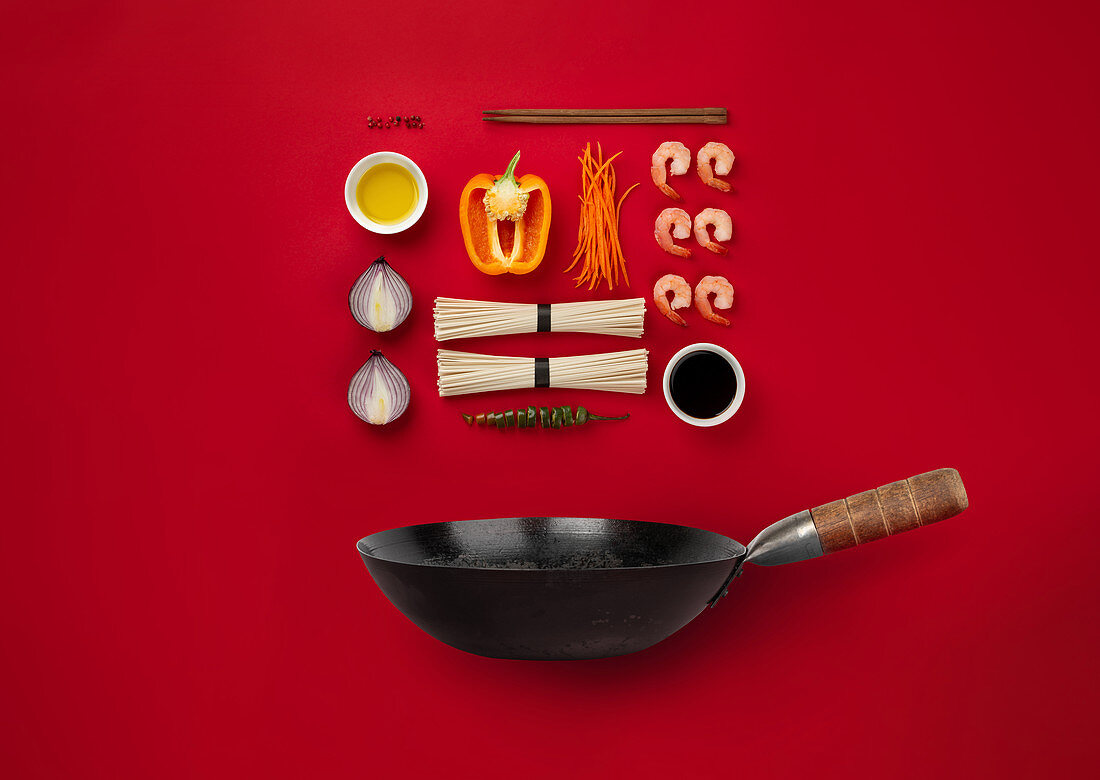 Ingredients for cooking noodles in wok pan