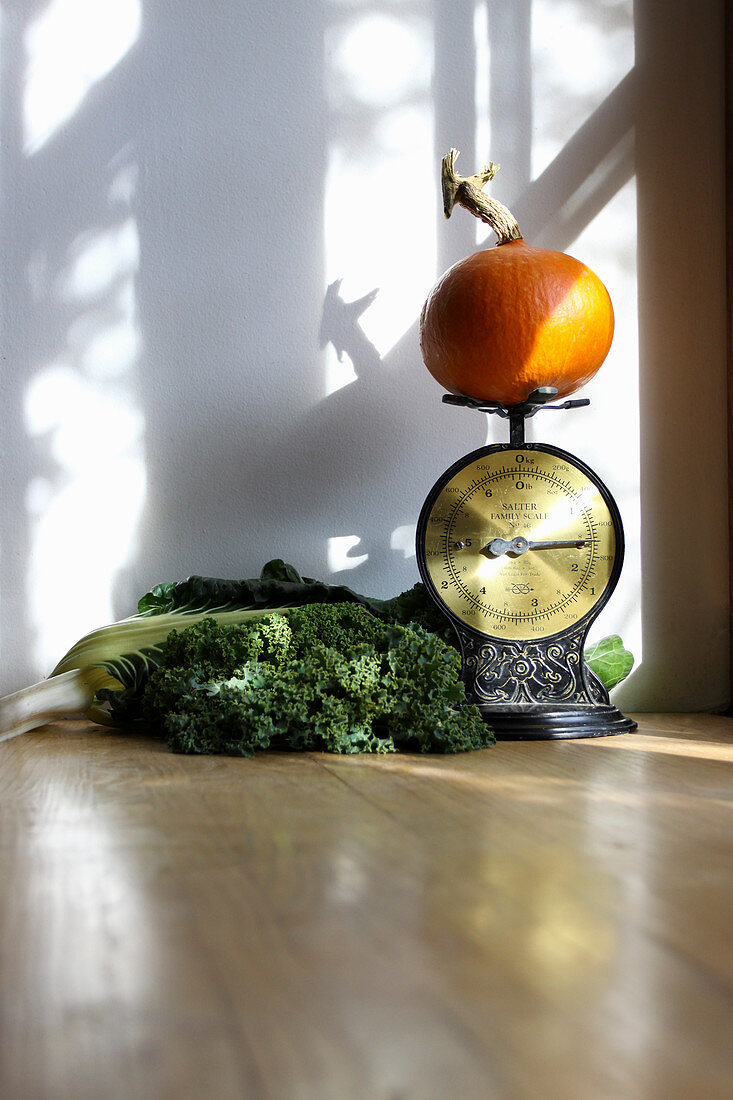 Freshly harvested home grown winter vegetables, placed on kitchen work surface