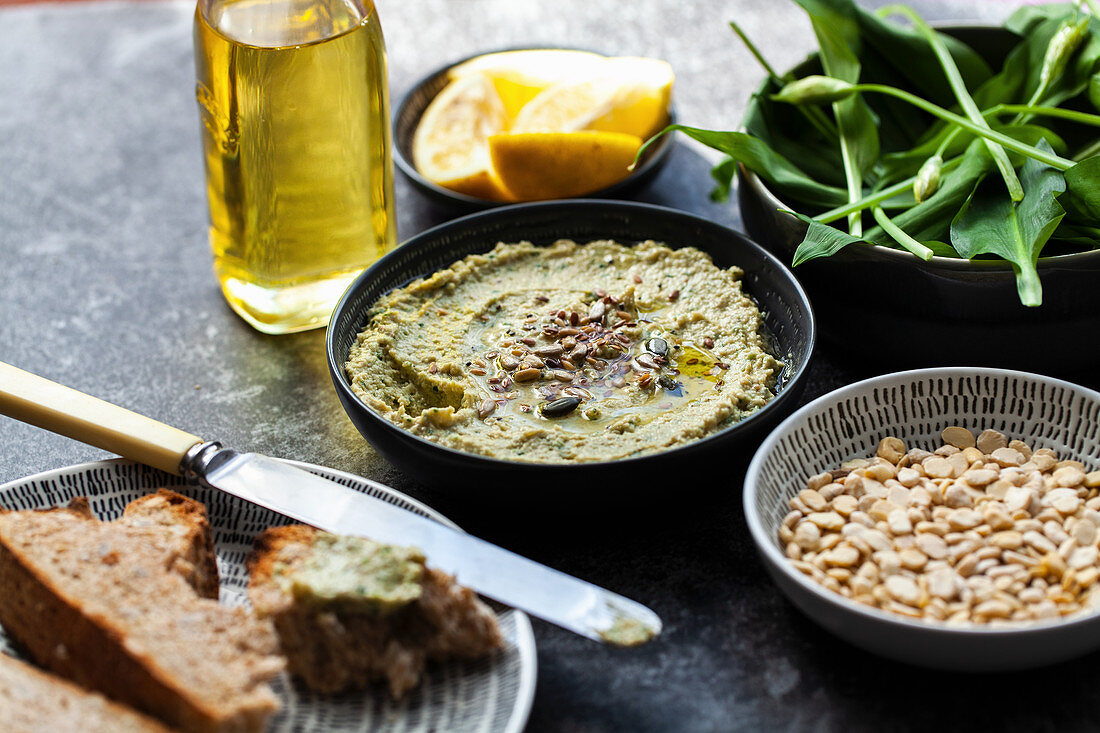 Fava bean hummus with lemon and wild garlic