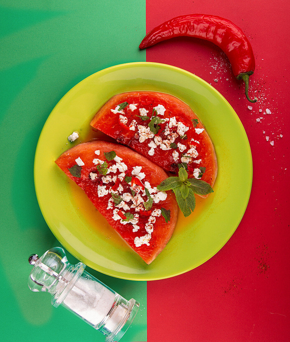 Grilled watermelon with feta cheese, chili pepper and mint