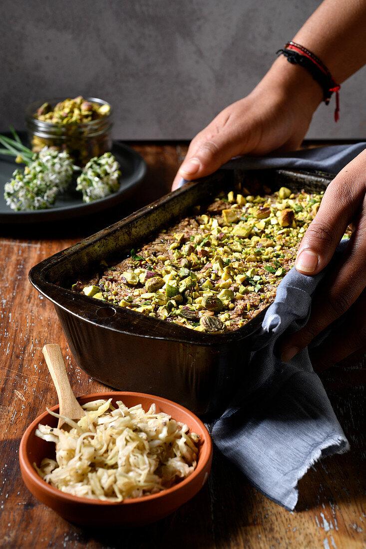 Herby nut roast with a pistachio crust and sauerkraut