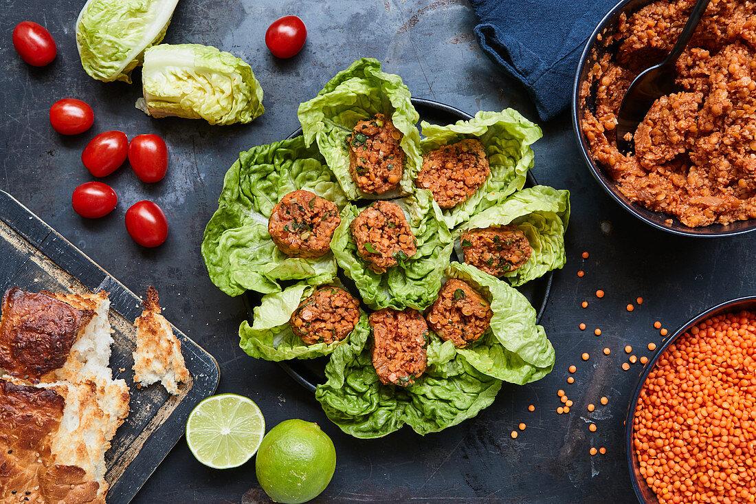 Red lentil balls served in lettuce leaves