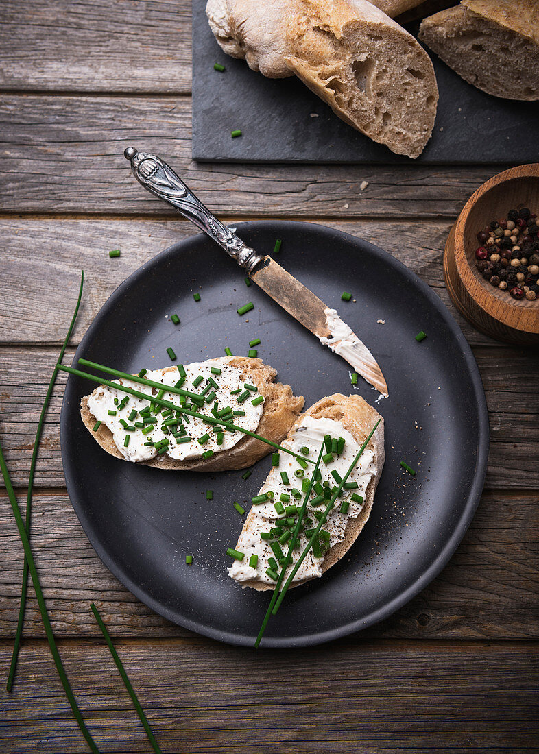 Spelt baguette with almond cream cheese and chives