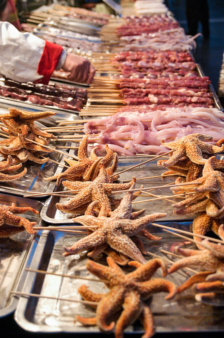 Starfish on skewers at Chinese market