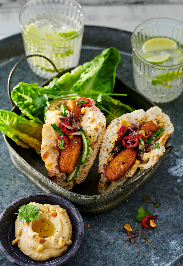 Mini unleavened bread filled with falafel served with cos lettuce and tahini