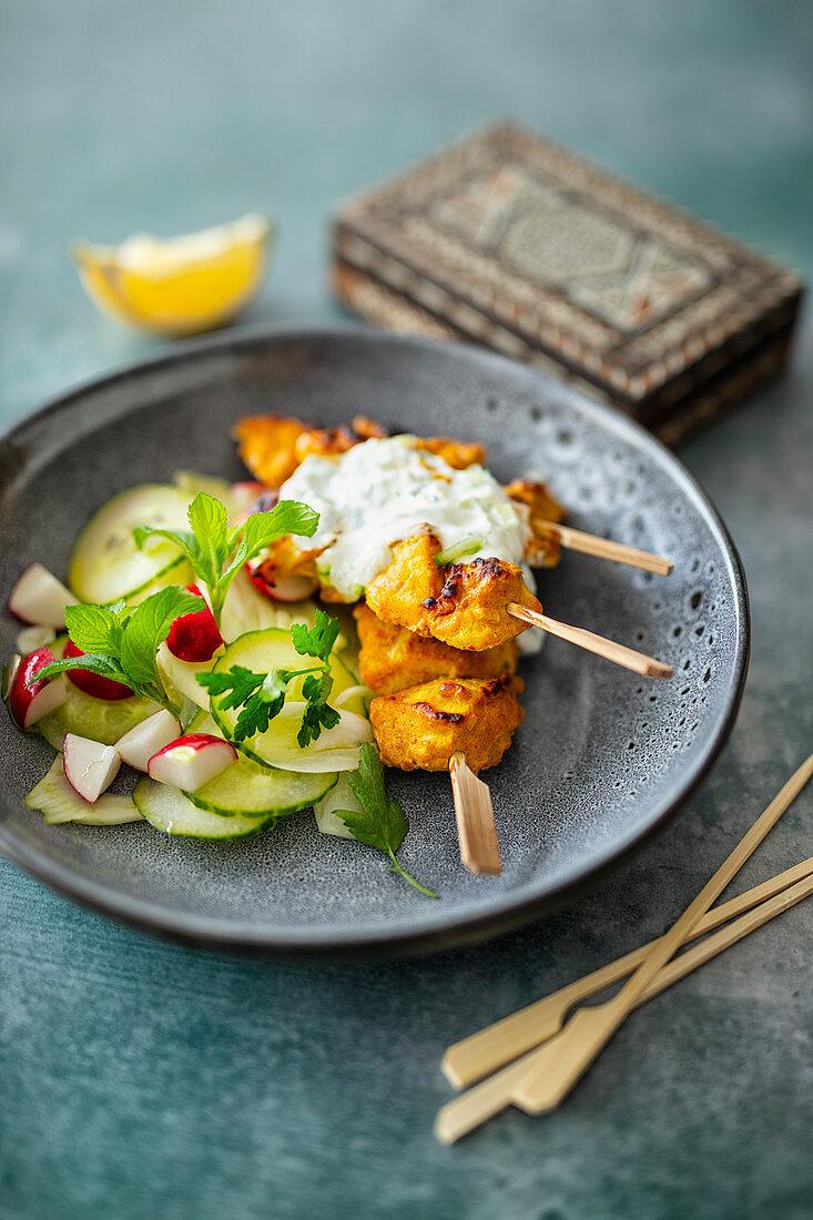Indian chicken tikka skewers with a yoghurt sauce