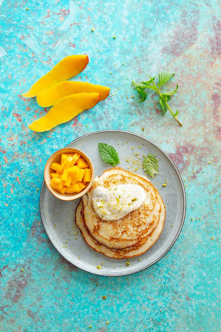 Uttapam (fermented rice pancakes, India) with mango and yoghurt