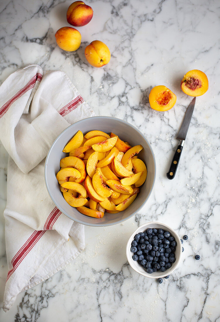 Nectarine and blueberry pie in the making