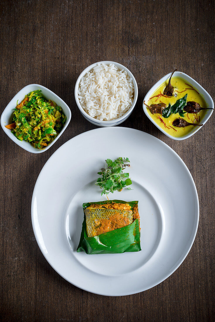 Seabass Wrapped in Banana Leaf with Vegetables and Rice