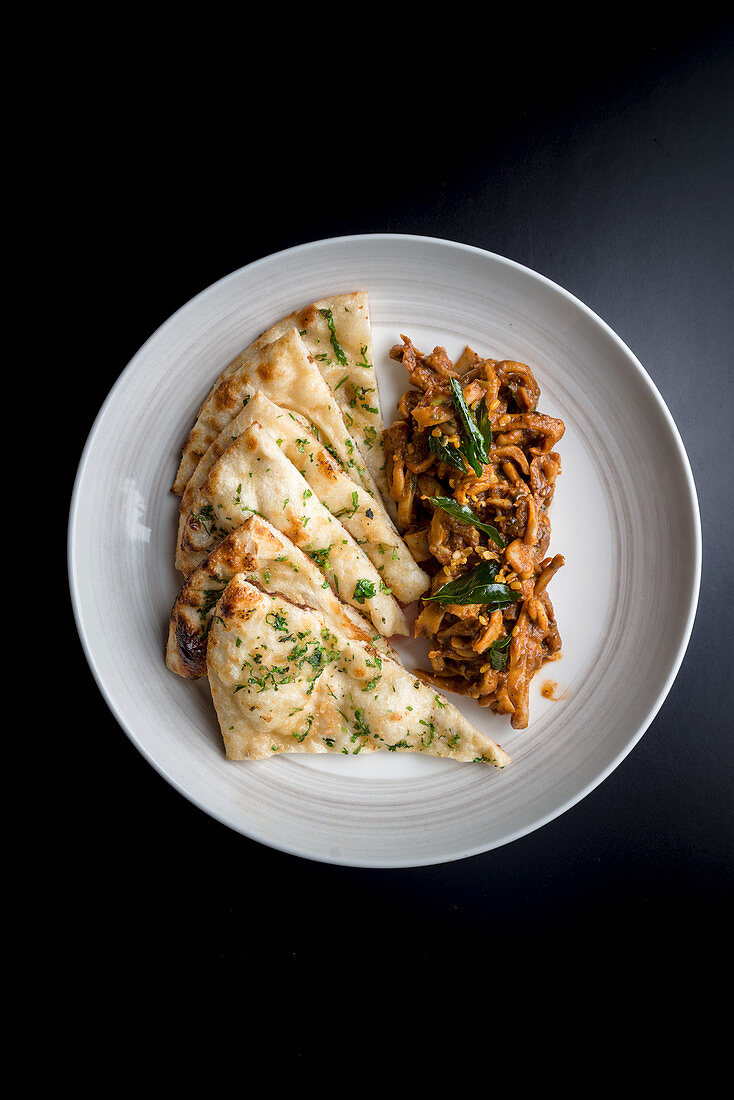 Stir fried squid with Indian bread (India)