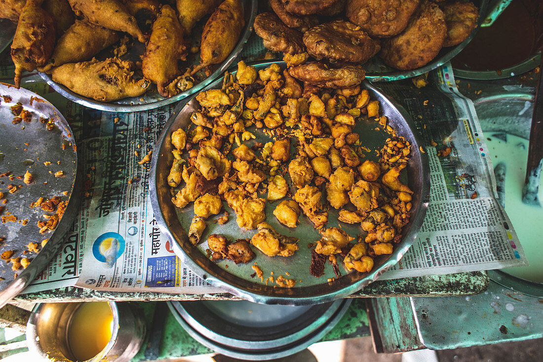 A shelf of street food snacks (India)