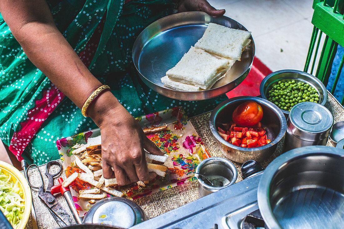 A woman preparing street food, India
