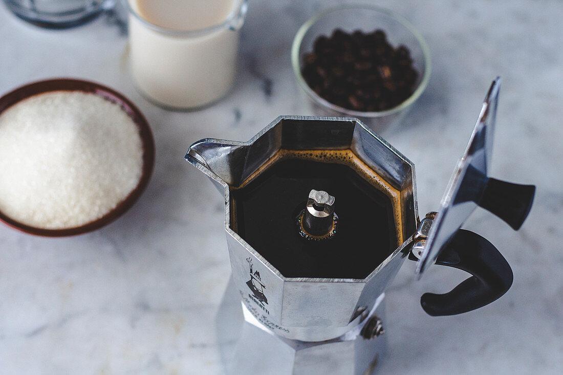 Ingredients for Dalgona Coffee: espresso, milk and sugar