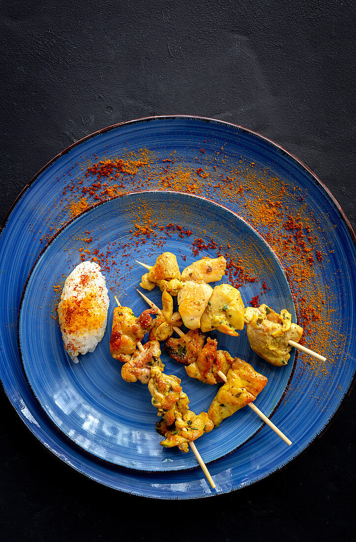 Homemade Moorish skewers with rice of meat with spices (Typical oriental food)