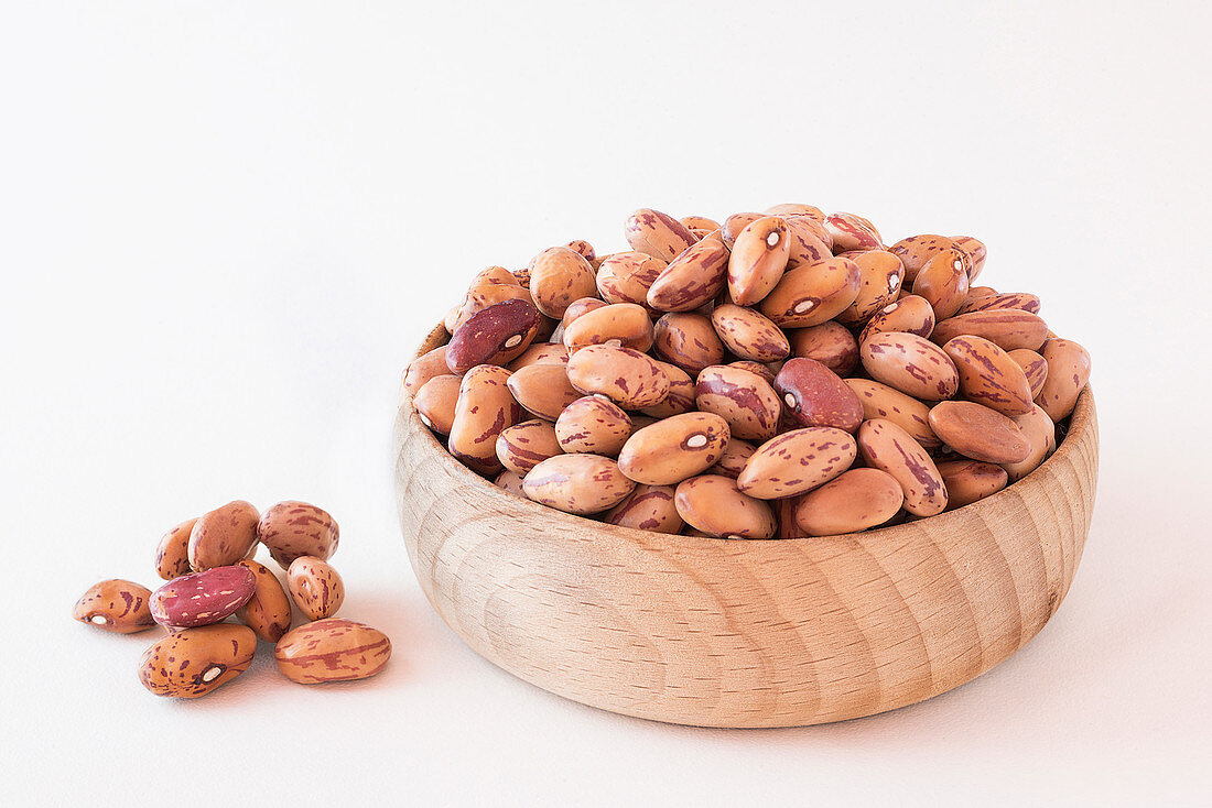 Dried borlotti beans in a wooden bowl