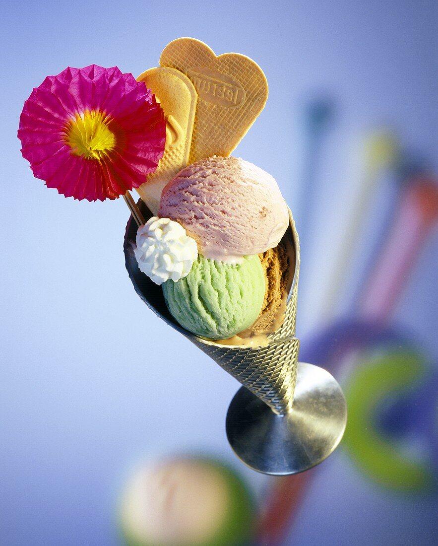 Ice cream sundae with three ice creams, cream & wafers