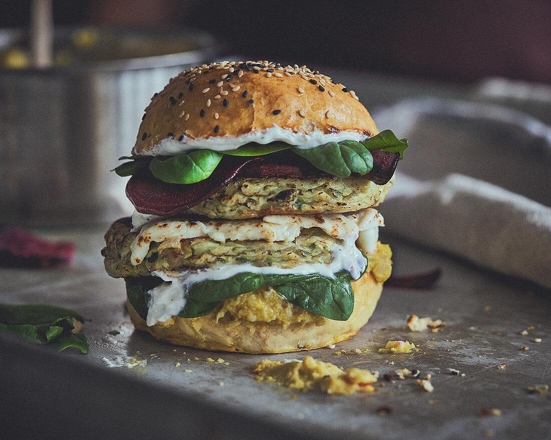 Veggie burger with zucchini patties, corn puree and yoghurt sauce