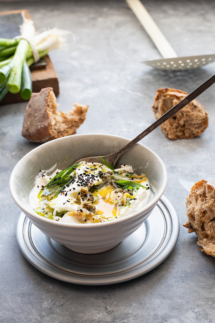 Turkish eggs with labneh scallion oil and scallion butter
