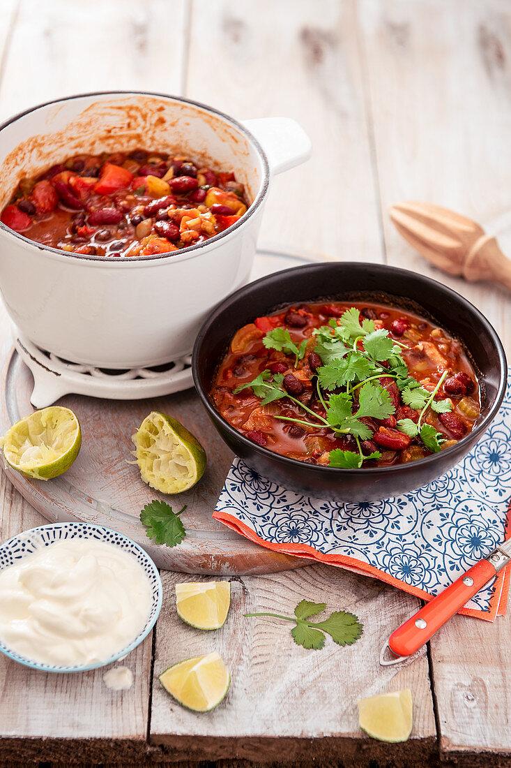 Vegeterian mexican bean chilli with chipotle chili, sour cream and coriander