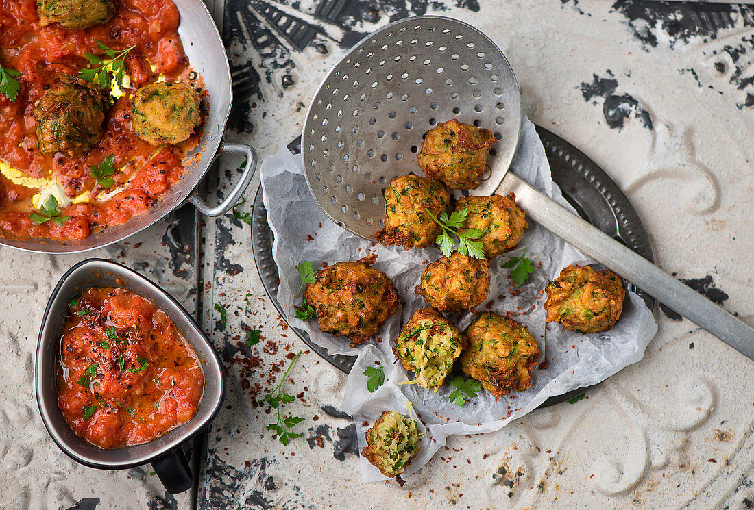 Courgette falafel with tomato sauce