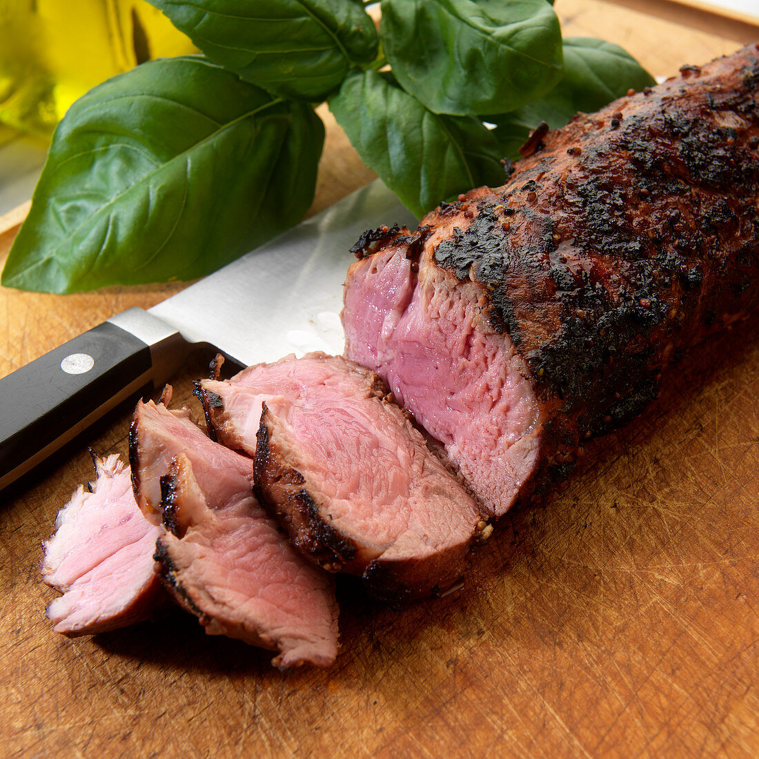 Sliced grilled pork tenderloin with herb rub