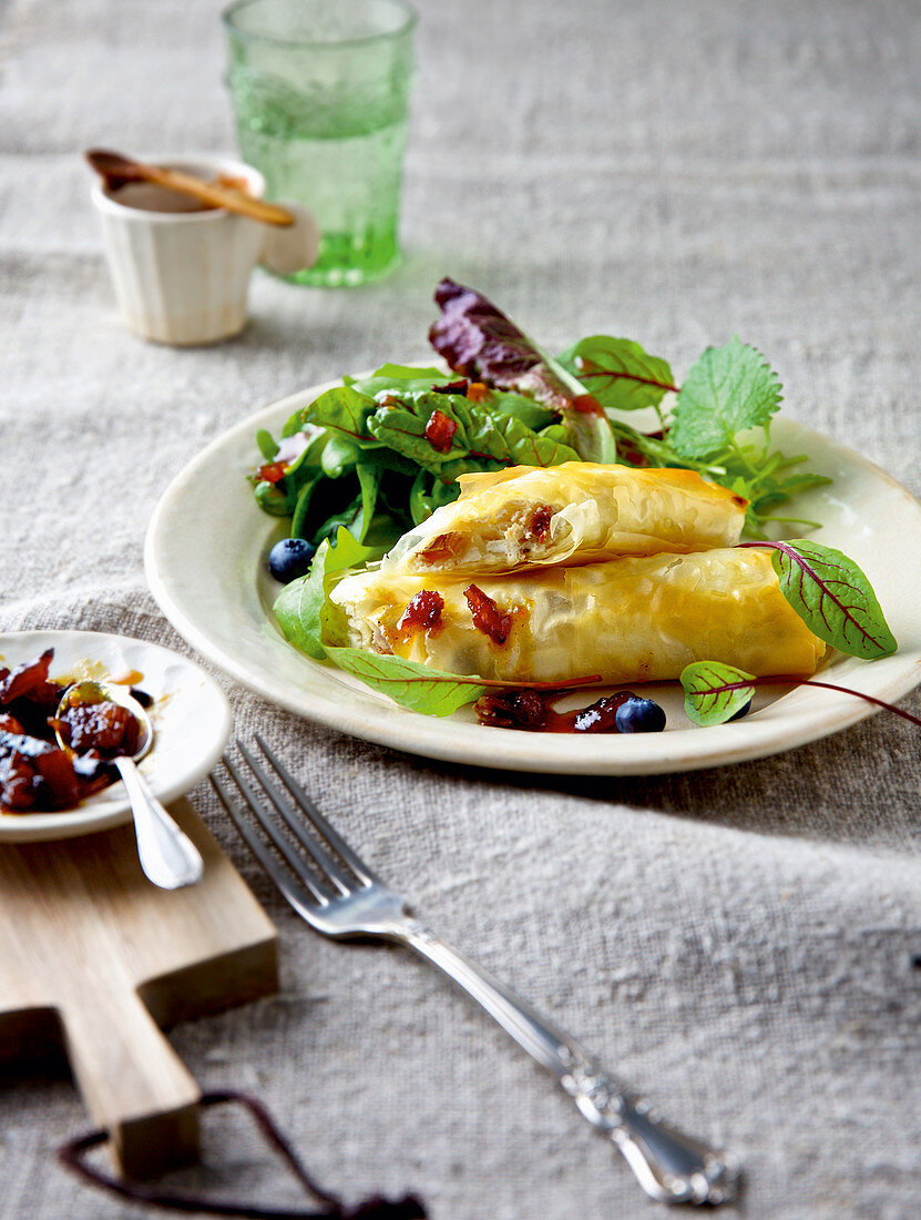 Fresh goat's cheese in filo pastry with wild herb salad and dates