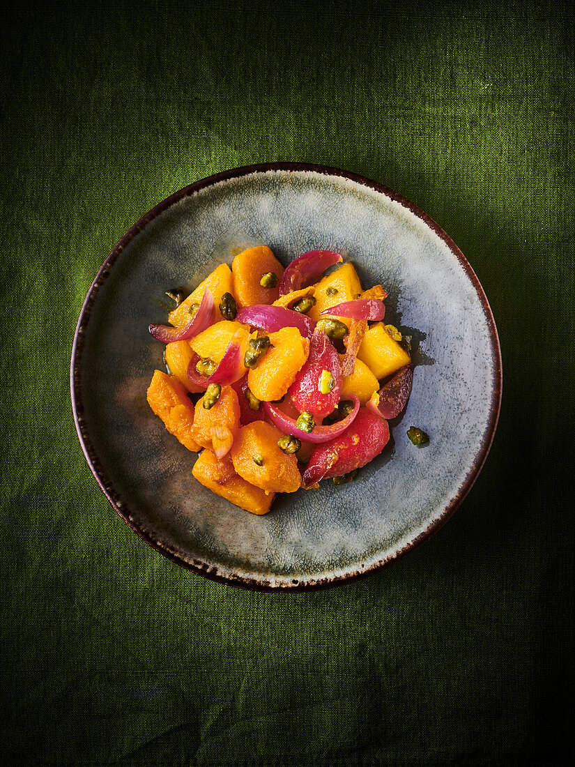 Butternut squash salad with pistachios and red onions