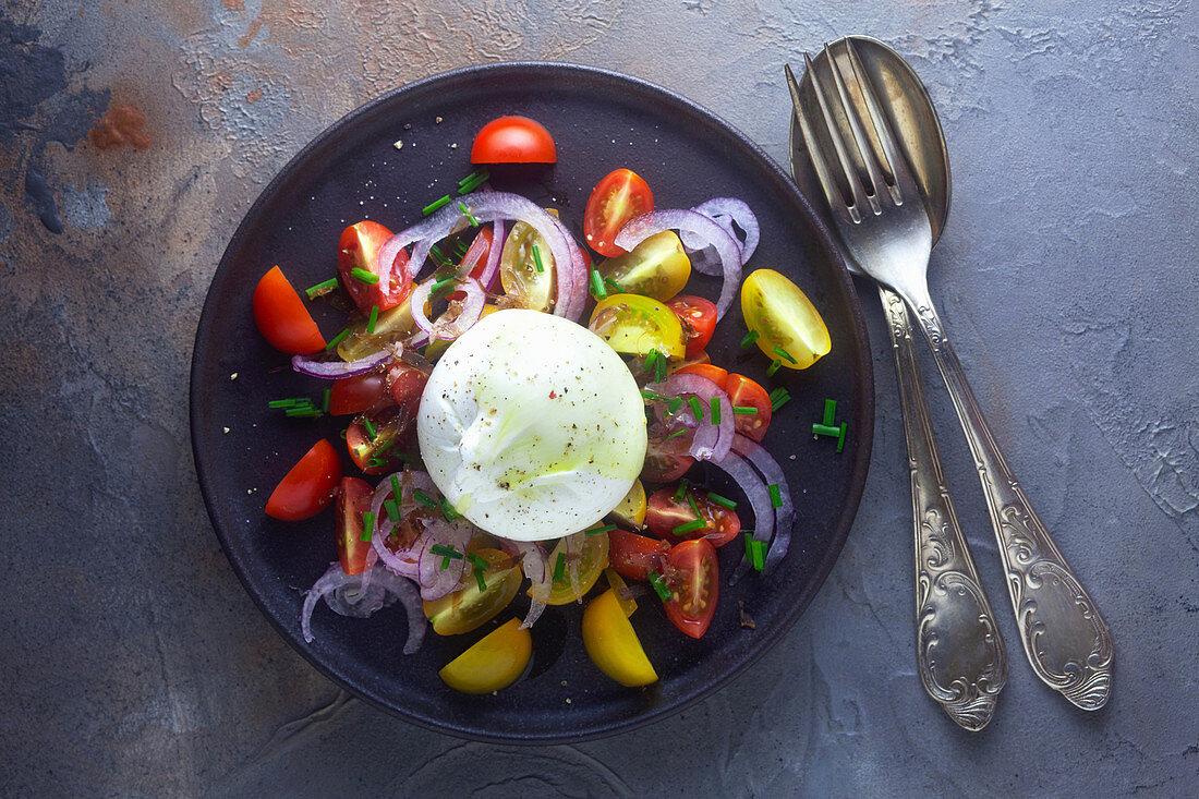 A tomato salad with burrata