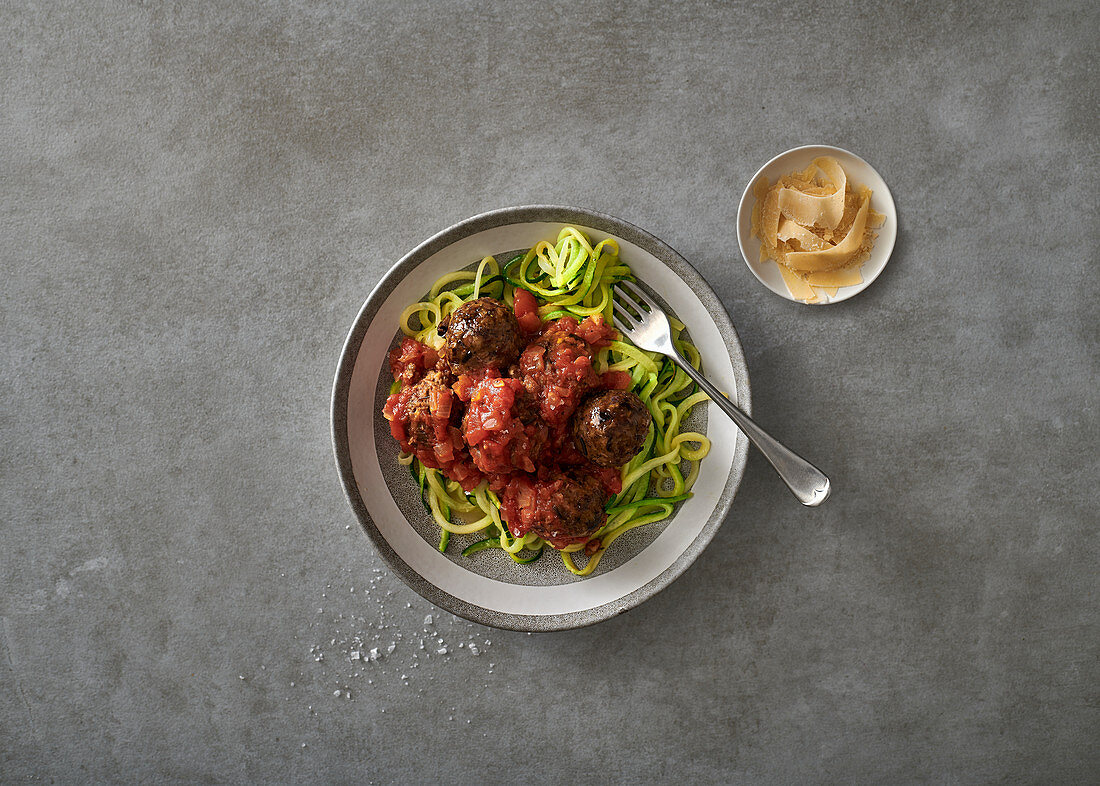 Aubergine meatballs in tomato sauce with baby marrow noodles