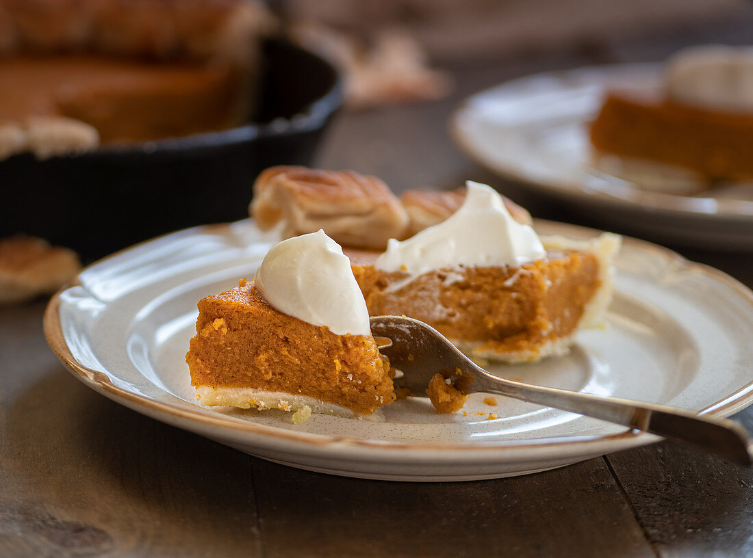 Homemade pumpkin pie baked in cast iron pan