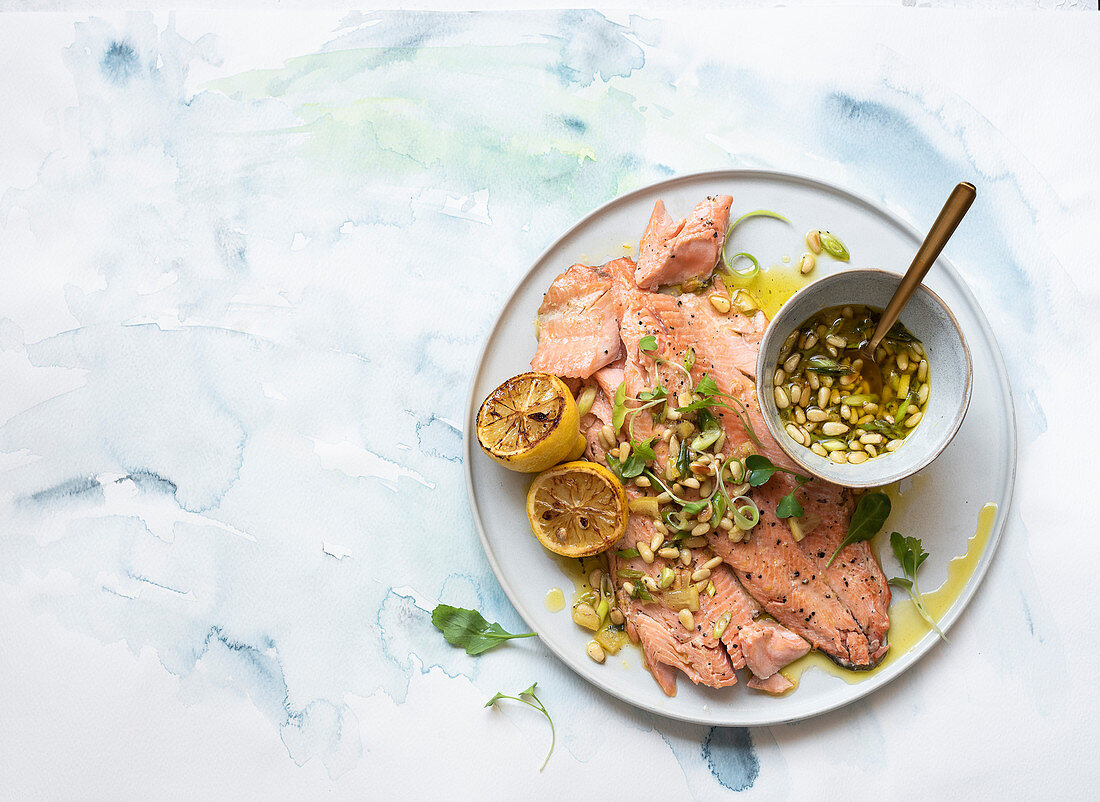 Rainbow trout with spring onion, pine nut and preserved lemon salsa