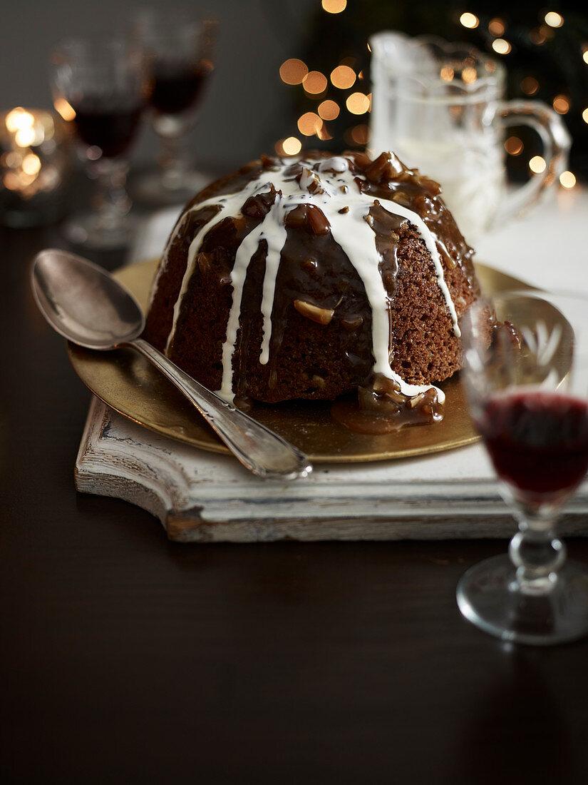 Christmas pudding with sticky fudge sauce