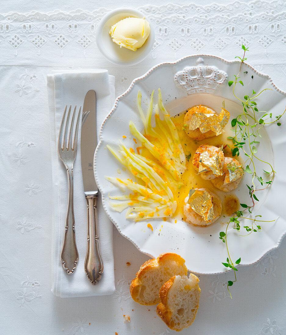 Pollock fillets in gold leaf with orange fennel